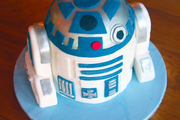 Image: A birthday cake in the shape of the Star Wars R2D2 character
