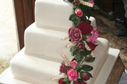 Three Tier Stacked Wedding Cake with handmade roses and wheat with rose foliage