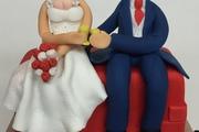Sugar Bride and Groom sitting