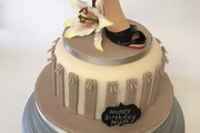 Hand made sugar stilletoe shoe with hand made sugar lily - on sticky gingerbread sponge cake with vanilla cream filling