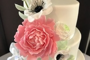 Hand made sugar peony, rununculus and anemone flowers with rose foliage