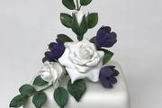 Handmade sugar roses, freesias and rose foliage