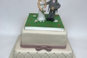 Simple cake with hand made topper of Bride and Groom