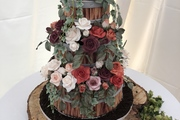 Three Deep Tiers - Rich Fruit Cake - Decorated to look like barrel planters and filled with handmade roses, rose foliage and ivy and finished with Oreo cookie crumbs for soil