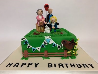 Bespoke Joint Birthday Cake with detailed topper